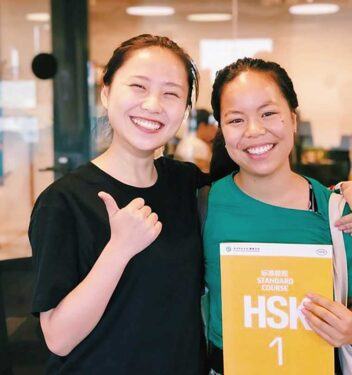 teacher_and_student_holding_hsk_book