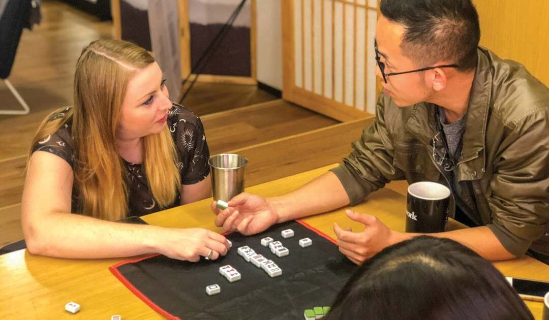2 people playing games as it is one of the best way to learn chinese