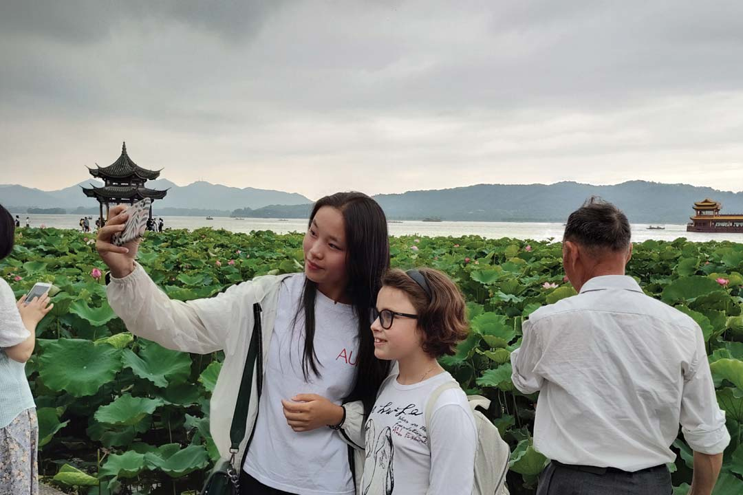 Student and chinese girl hanging out during a homestay in China