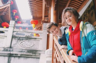 2 people hanging out at a chinese temple
